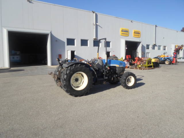 used tractor new holland with hydraulic right boom