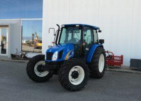 trattore usato new holland tl 100A profilo destro
